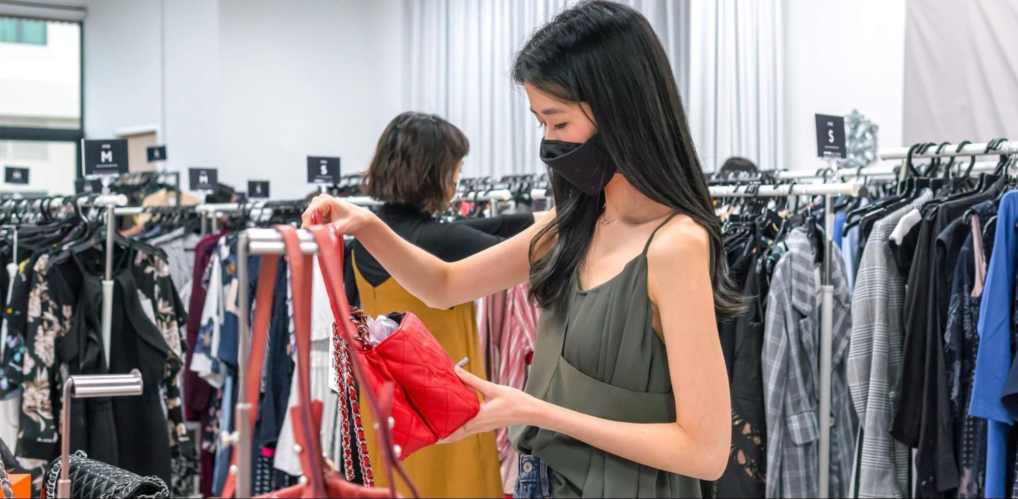 masked girl shopping
